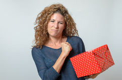 Angry Woman Holding Red Gift Box Stock Photography