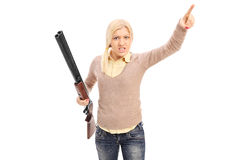 Angry woman holding a rifle and pointing with finger Royalty Free Stock Photography