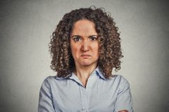 Angry woman isolated on grey wall background Royalty Free Stock Image
