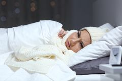 Free Angry Woman Keeping Warm In The Bed In A Cold Winter Royalty Free Stock Photos - 126964558