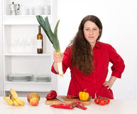 Angry woman in the kitchen Stock Photo