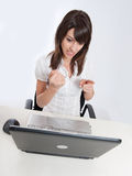 Angry woman with laptop Stock Photography