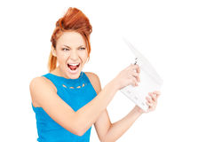 Angry woman with laptop computer Royalty Free Stock Images