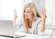 Angry woman with laptop Royalty Free Stock Image