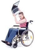 Angry woman with laptop on wheelchair Royalty Free Stock Photo