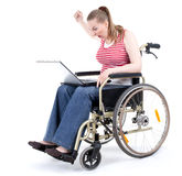 Angry  woman with laptop on wheelchair Stock Photography