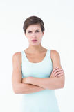 Angry woman looking at camera with arms crossed Royalty Free Stock Image