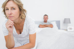 Angry woman looking at camera after fight with husband. Angry women looking at camera after fight with husband in bedroom at home Royalty Free Stock Photos