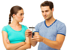 Angry Woman Looking At Man Cutting Credit Card Stock Photography