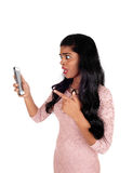 Angry woman looking at phone. Royalty Free Stock Image
