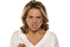 Angry woman. Angry and mad beautiful middle-aged woman royalty free stock photography