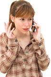 Angry woman making a phone call. Over white background Royalty Free Stock Photos