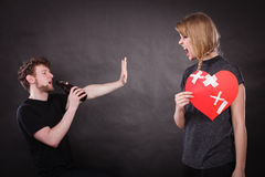 Angry woman and man addicted to alcohol. Broken heart. Royalty Free Stock Photos