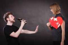 Angry woman and man addicted to alcohol. Broken heart. Unhappy couple. Family and alcoholism problems. Addiction and trouble of drinking. Man with alcohol Royalty Free Stock Image