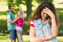 Angry woman with man and girlfriend in background at park Stock Images
