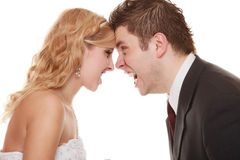 Angry woman man yelling at each other. Fury bride groom. Wedding couple relationship difficulties. Angry women men yelling at each other. Portrait fury bride royalty free stock photos