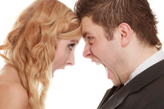 Angry woman man yelling at each other. Fury bride groom. Wedding couple relationship difficulties. Angry women men yelling at each other. Portrait fury bride royalty free stock images