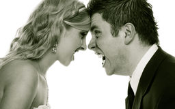 Angry woman man yelling at each other. Fury bride groom. Wedding couple relationship difficulties. Angry women men yelling at each other. Portrait fury bride stock images
