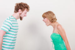 Angry woman and man yelling at each other. Royalty Free Stock Photos