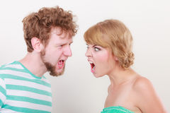 Angry woman and man yelling at each other. Royalty Free Stock Image