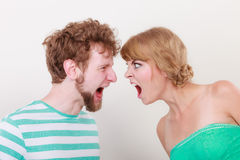 Angry woman and man yelling at each other. Stock Photography