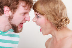 Angry woman and man yelling at each other. Royalty Free Stock Photo