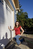Angry Woman Near House - Vertical Stock Images