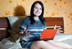 Angry woman with notebook Royalty Free Stock Photo