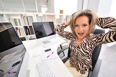 Angry woman at the office Stock Photo