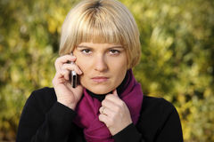 Angry woman on the phone royalty free stock photos