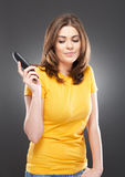 Angry woman with phone Royalty Free Stock Image