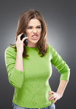 Angry woman with phone Stock Photography