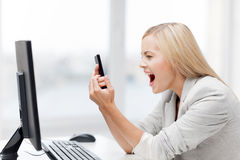 Angry woman with phone Royalty Free Stock Photo