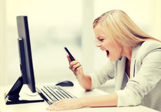 Angry woman with phone Stock Image