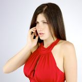 Angry woman on the phone Royalty Free Stock Images
