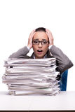 The angry woman with piles of paper on white Stock Images