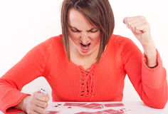 Angry woman with playing cards Stock Photo