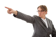 Angry woman pointing away - woman isolated on white background royalty free stock images