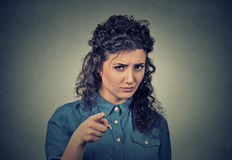 Angry woman pointing at camera Royalty Free Stock Images