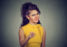 Angry woman pointing finger at camera Royalty Free Stock Photography