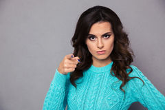 Angry woman pointing finger at camera Stock Photography