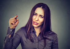 Angry woman pointing her finger accusing someone Stock Images