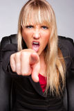 Angry Woman Pointing. Angry yelling business woman pointing Royalty Free Stock Images