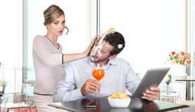 Angry woman pulling cake in face to boyfriend cheating Royalty Free Stock Photos