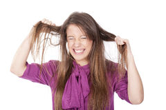 Angry woman pulling her hair Stock Images