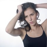 Angry woman pulling her  hair. Studio portrait of a pretty woman pulling her hairs with an angry expression on face Stock Photography
