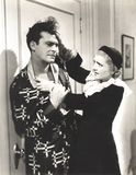 Angry woman pulling man's hair Stock Images