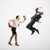 Angry woman punching businessman Royalty Free Stock Photo