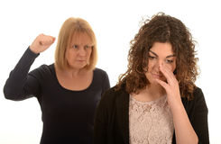 Angry woman. With raised fist and upset person in the foreground, isolated on a white background Royalty Free Stock Photography