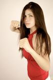 Angry woman ready to punch and kick ass. Beautiful female model strong fighting with fist Royalty Free Stock Images